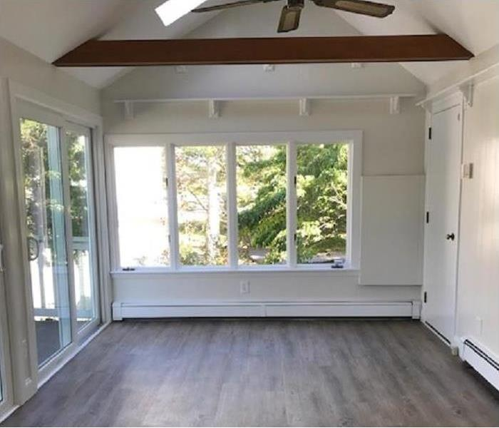 the sunroom, new floor, painted walls, empty and fresh