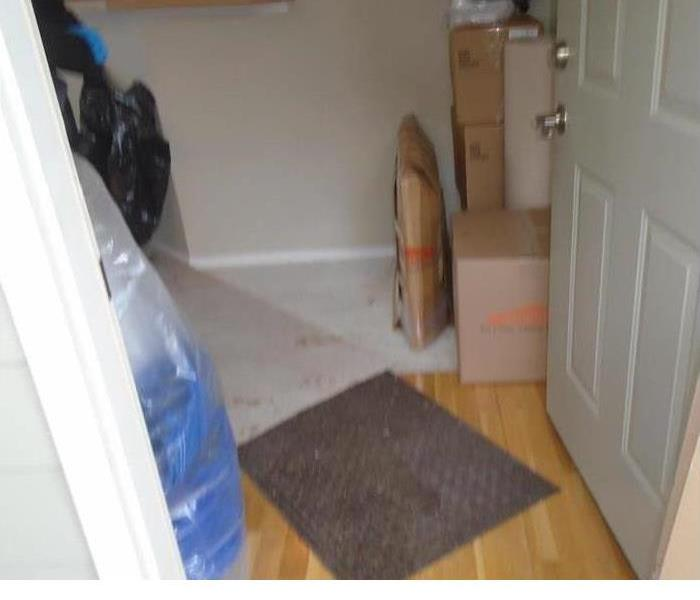 Seattle area home suffered water damage to flooring and walls Before