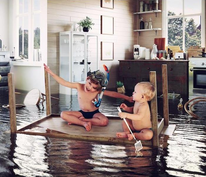 kids play on the table while flooding in the kitchen