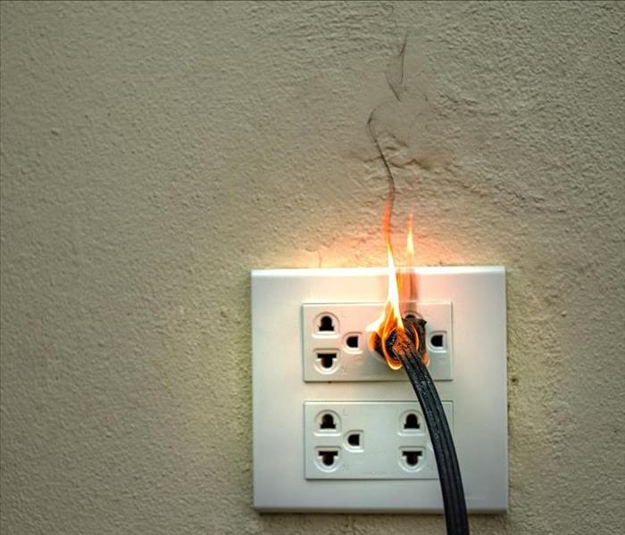 electrical outlet  catching fire