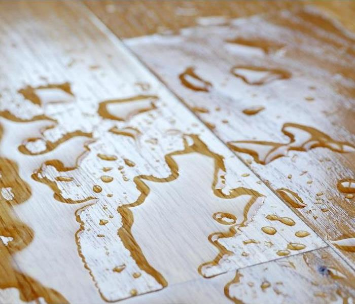 Water drops on wooden surface