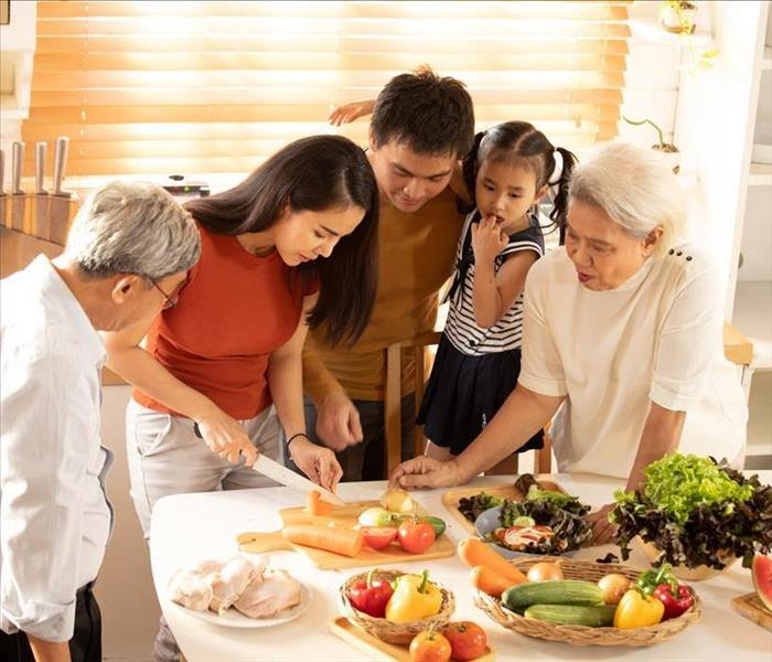 family preparing food on table