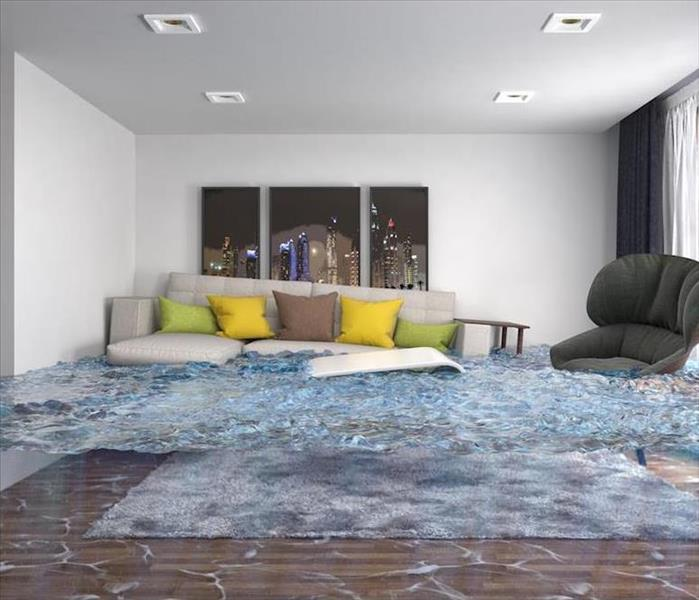 flooded living room with beige couch and tables